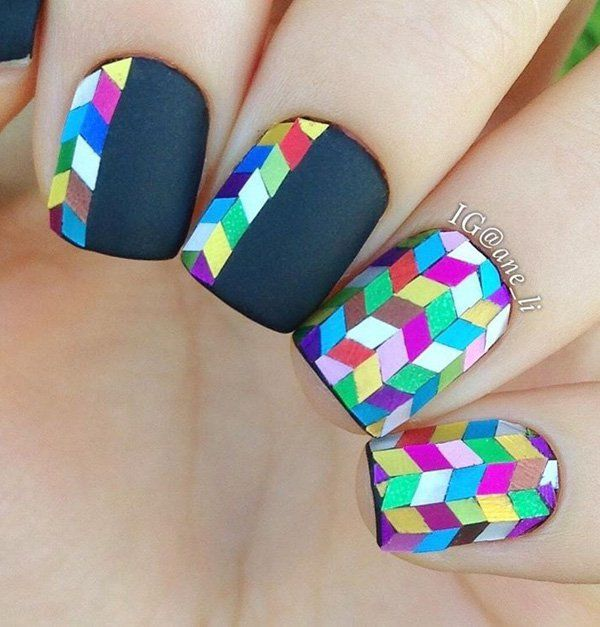 If you're a little more creative and you have more time, you can try this cool nail art design. Use a darker matte nail polish as base. Then you may need different colors of nail stripes. Cut them into smaller triangles and then tape them to your nails just like here.