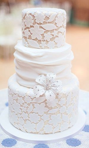 wedding cakes but with finer lace and different flower or old fashioned brooch