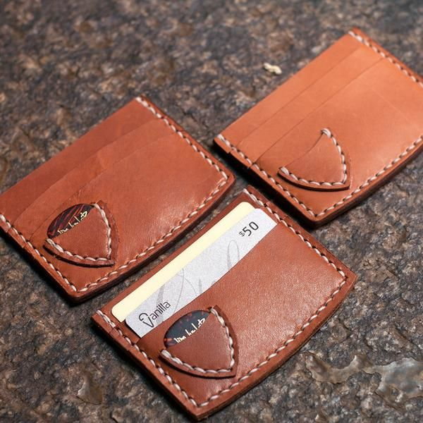 The Guitar Pick Card Wallet. Store some cards, cash, and a guitar pick for your daily journey's. The default setup features 2 card slots on the front and one la