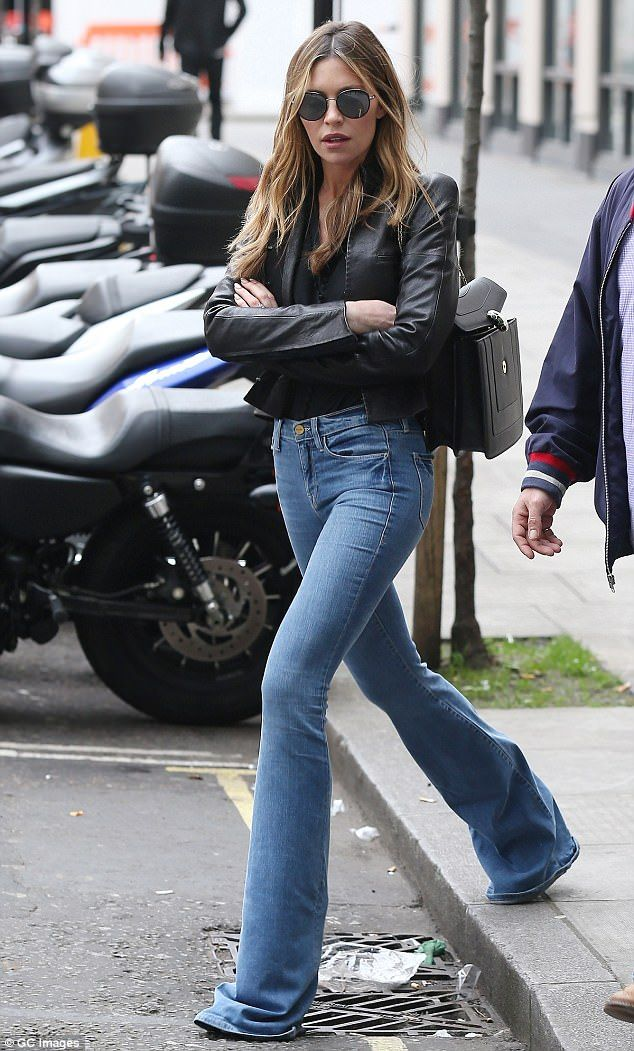 Finishing touches: The former Strictly Come Dancing champion added to her latest look with a pair of heavily tinted Aviator sunglasses, while a tasteful black leather handbag rounded things off
