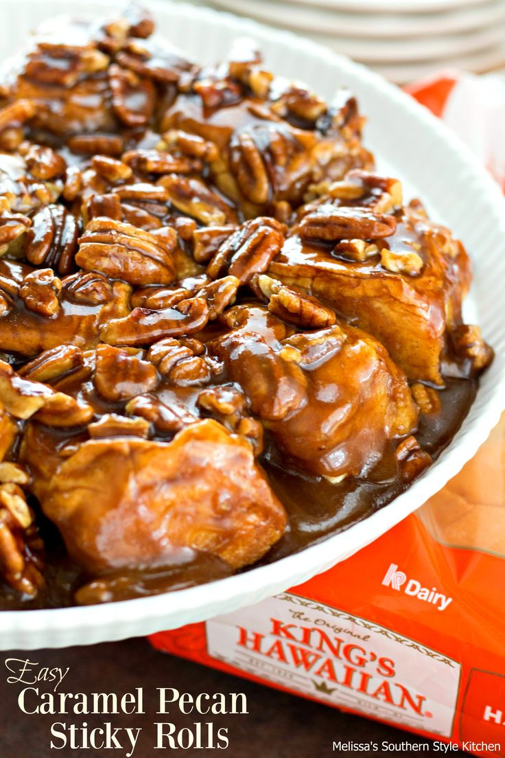 """Start your Memorial Day weekend with these gooey and oh-so-easy caramel pecan sticky rolls using one of my family's favorite dinner rolls. These sweet rolls begin with butter, brown sugar and pecans that are cooked together to form the perfect combination to add the """"sticky"""" to this sweet treat. Thanks to Kings Hawaiian Original Hawaiian Sweet Rolls no dough making or kneading is required."""