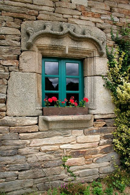 I love the bright window color against the gray stone outer wall.