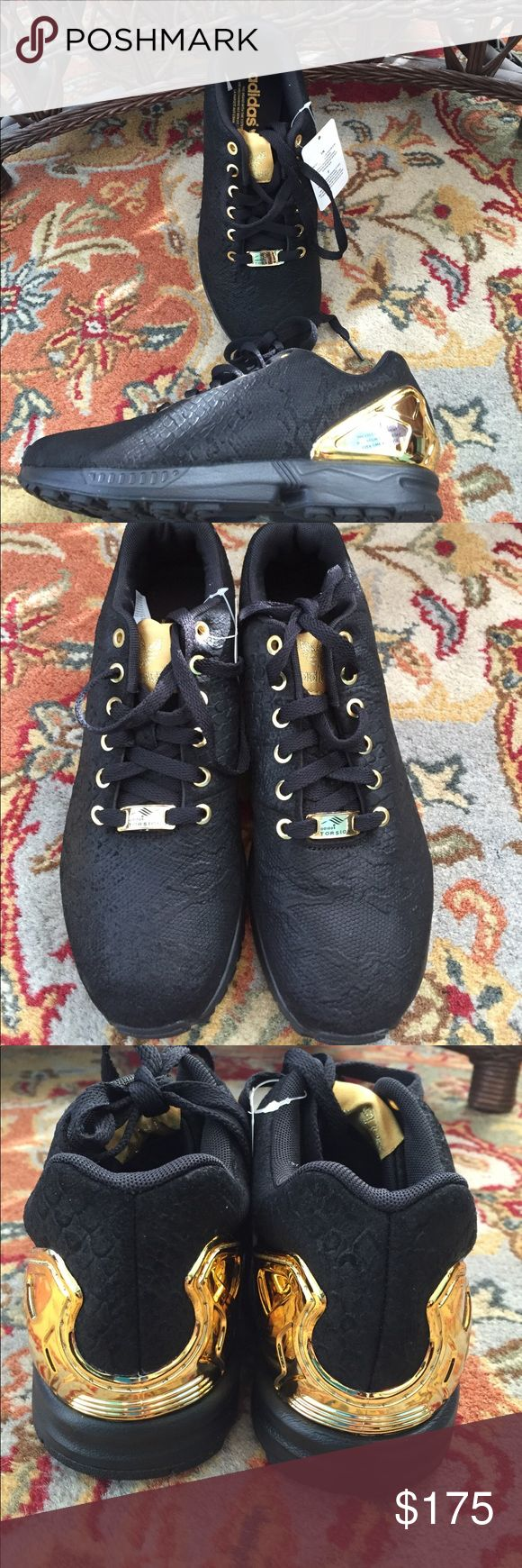 Wow! Adidas Torsion ZX Flux black gold sneakers! WILL TAKE A REASONABLE OFFER!!!    Brand new with tags and stickers. No box. Black reptile embossed nubuck. Gold accents. Men's size 8. Adidas Shoes Sneakers
