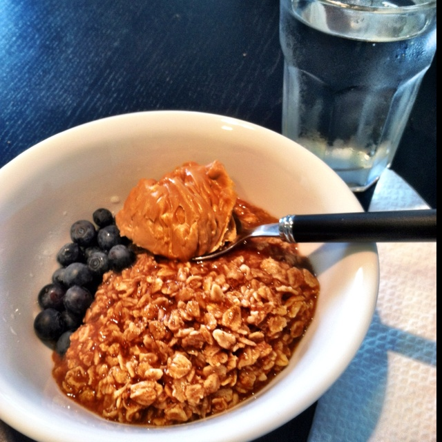 The only way to eat oatmeal: oats cooked from scratch with cinnamon, blueberries, and a big spoonful of peanut butter that melts when stirred together.