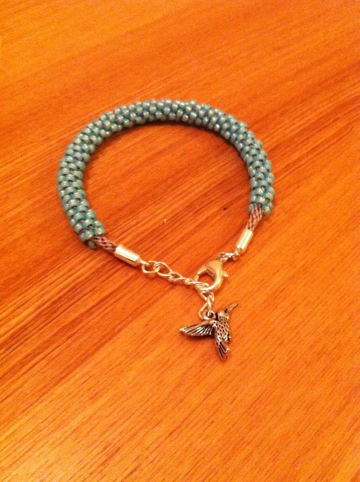 Turquoise beaded kumihimo with humming bird charm