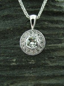 This custom halo pendant was created around the customer's .57ct round brilliant diamond from her first engagement ring.
