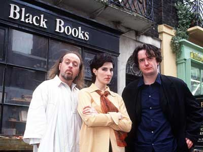 Black Books TV series from 2000-2004 ~ Bill Bailey as Manny Bianco, Tamsin Greig as Fran Katzenjammer, Dylan Moran as Bernard Black.  Revolves around the 3 characters and is about Bernard who runs his own bookshop even though he doesn't much like people who buy books and hates having customers.