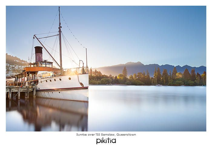 Postcard 'Sunrise over TSS Earnslaw, Queenstown' which is found in Pikitia's high quality range of postcards