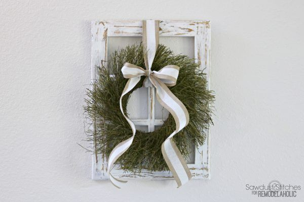 Build this easy DIY decorative window frame and make your seasonal decorating swaps as easy as switching a wreath. Perfect for Christmas and all year!