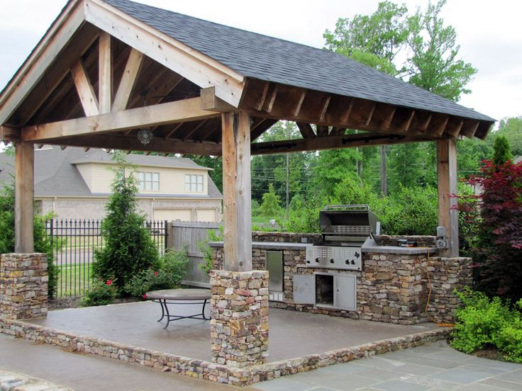 Outdoor kitchen with pergola and stone work.