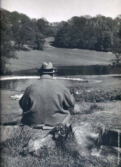 British Prime Minister Winston Churchill with his poodle, Rufus, in the gardens of his Chartwell estate, 1951. Photo by Philippe Halsman