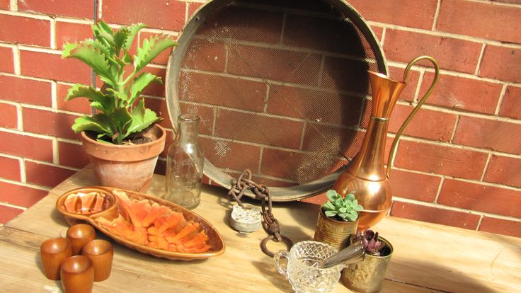 Vintage styling: Autumn warmth.  Rustic sieve, retro dip bowl, copper accents, crystal, vintage silver spoons and succulents.  More vintage ideas and items for sale @ https://www.facebook.com/pages/Rubys-and-Pearls/744861835533003