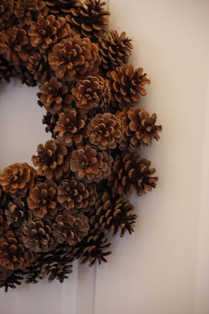 A DIY pinecone wreath. So easy! To save money, I construct a ring myself out of twisted newspaper, wire, or popsicle sticks.