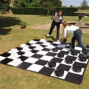 Giant checkers - you can do a home made version of this using two colors of pavers and bucket lids. Doubles as a patio when not in use.