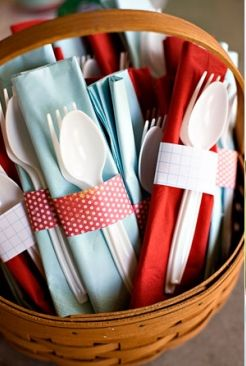 Dress up paper and plastic party ware.  Fold the napkins and secure with colorful paper napkin rings.