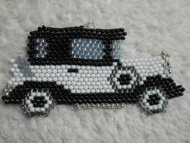 A model a car made out of seed beads pendent