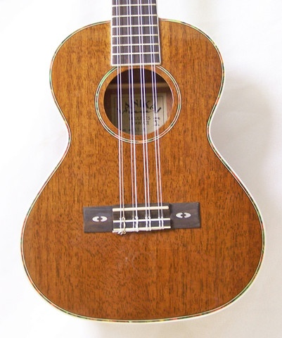 The Lanikai 8-string tenor ukulele is an intriguing instrument. It's tuned just like a standard 4 string uke (GCEA), but gives an extra flavour with wound nylon strings an octave lower on the G and C and gives a chorus effect with matching notes on the E and A strings. It features a nato top, back & sides, rosewood fretboard and Gold in-line tuning machines.