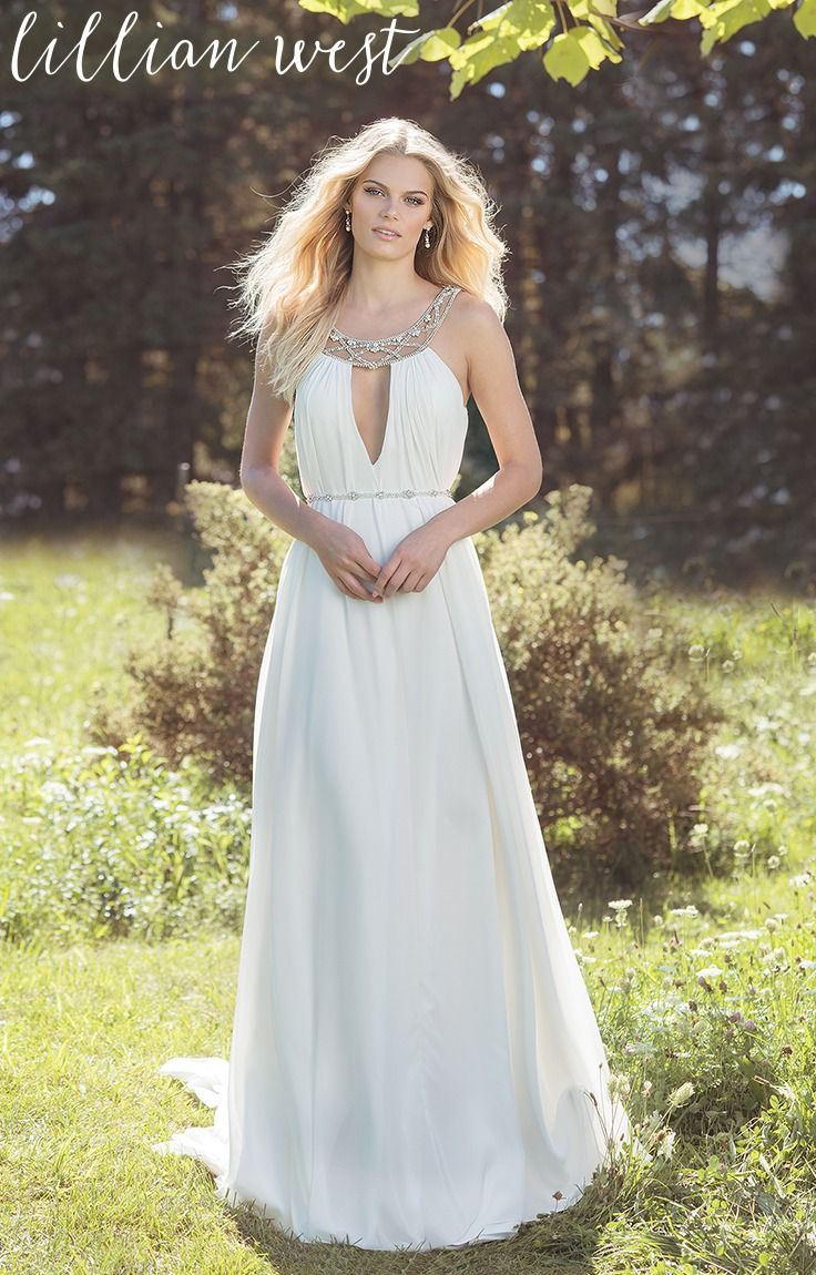 This comfortable kaftan-style dress has a distinctly Grecian influence. Beaded illusion collar and a plunging neckline brings a modern etheral look to your wedding day while the chiffon shift skirt creates effortless movement.