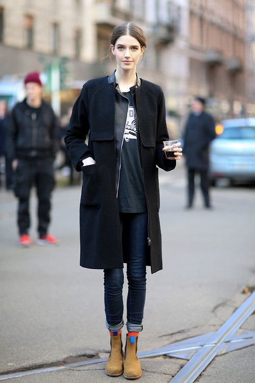 Shop this look for $174:  http://lookastic.com/women/looks/jacket-and-skinny-jeans-and-chelsea-boots-and-overcoat-and-crew-neck-t-shirt-and-socks/1649  — Black Leather Jacket  — Navy Skinny Jeans  — Tan Suede Chelsea Boots  — Black Coat  — Black and White Print Crew-neck T-shirt  — Orange Socks