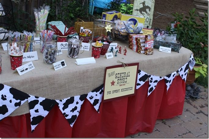 cowboy tablescape...I love the burlap with red underneath.  Then add the cow banner!