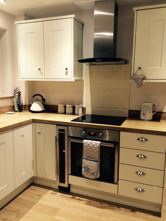 Cream shaker style kitchen subway tiles solid oak worktops