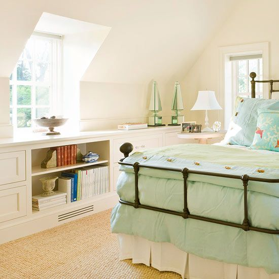 Low/slanted ceilings in a bedroom? Add a long, low built in with shelves and drawers to take the place of a taller dresser, etc. Could pull double or triple duty and work as a window seat and display area.