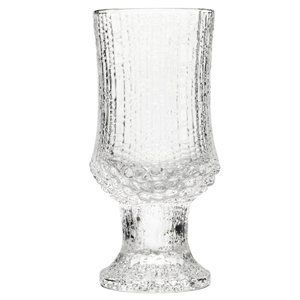 iittala Ultima White Wine set/2 by Iittala. $50.00. An exclusive design reflecting the thousands of hours spent perfecting the glass-blowing technique required to produce the effect. This distinctive classic from the 1960s contributed to Iittalaâ?TMs international breakthrough. The patterns gradually change as the glass burns the surface of the wooden molds.