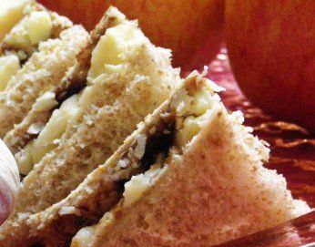 Cheese and Pickle Sandwich. Cheddar Cheese and Branston Pickle  Makes 4 small tea sandwiches  2 slices of brown bread Cheddar cheese Soft butter Branston Pickle  Slice the cheddar. I recommend about 2-3mm in thickness. You need to be able to taste the cheese in the bread, but not have it too thick either.  Butter the bread.  10 Lay the cheese on one of the slices of bread, covering the whole slice.  Spread a small amount of Branston Pickle (to your taste, really) over the cheese. Branston…