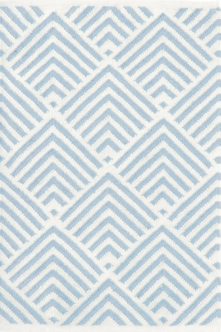 Dash & Albert   Cleo Blue Indoor/Outdoor Rug   A traditional kilim weave gets the indoor/outdoor treatment in eco-friendly recycled materials and a woof-worthy graphic pattern in classic ivory and a single gorgeous color. Variations in color are expected.