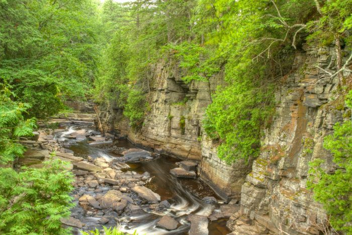 Situated south of L'Anse, off US 41, the scenic Canyon Falls and Gorge is a true treasure of the Upper Peninsula. No trip to the U.P. is complete without a stop at this gorgeous location on the banks of the Sturgeon River.