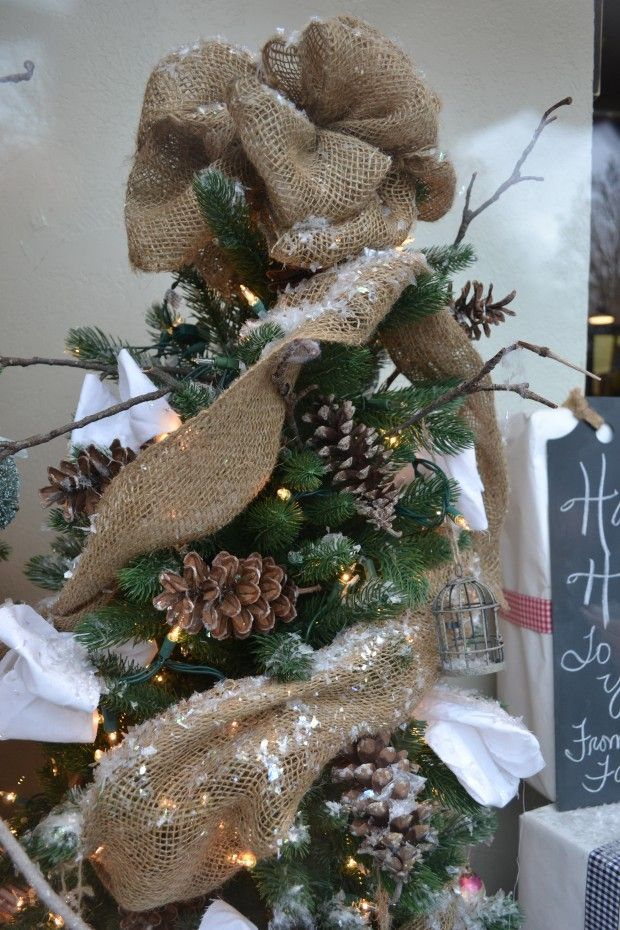 Decorate your tree with a burlap topper and ribbon