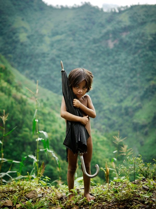 A girl from the Chepang tribe in the highlands of southern Nepal. The girl was on herway to guard a corn crop against monkeys.