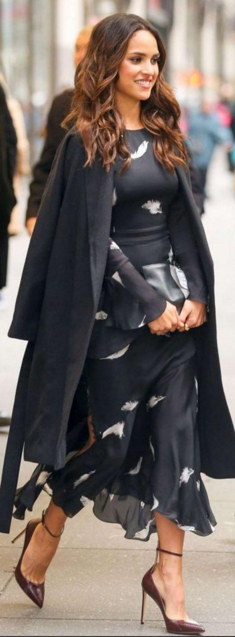 Who made  Adria Arjona's black feather print dress?