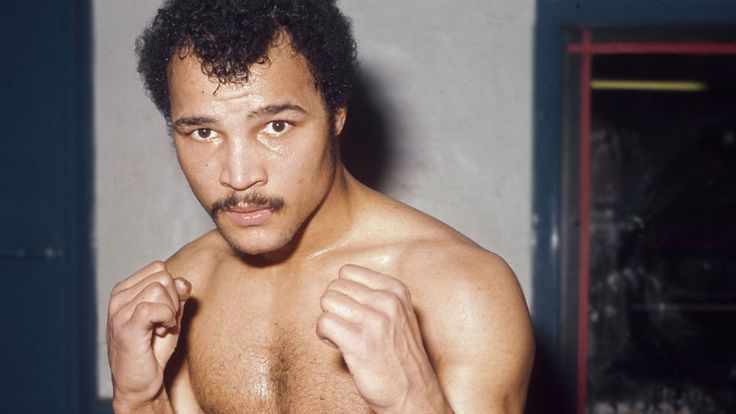 John Conteh. He won World light Heavyweight title in 1974, which he held for three years.Fights, 39,wins 34(by KO 24)Defeats 4, 1 Draw. He also won Commonwealth Middleweight Gold medal in 1970.B 1951.