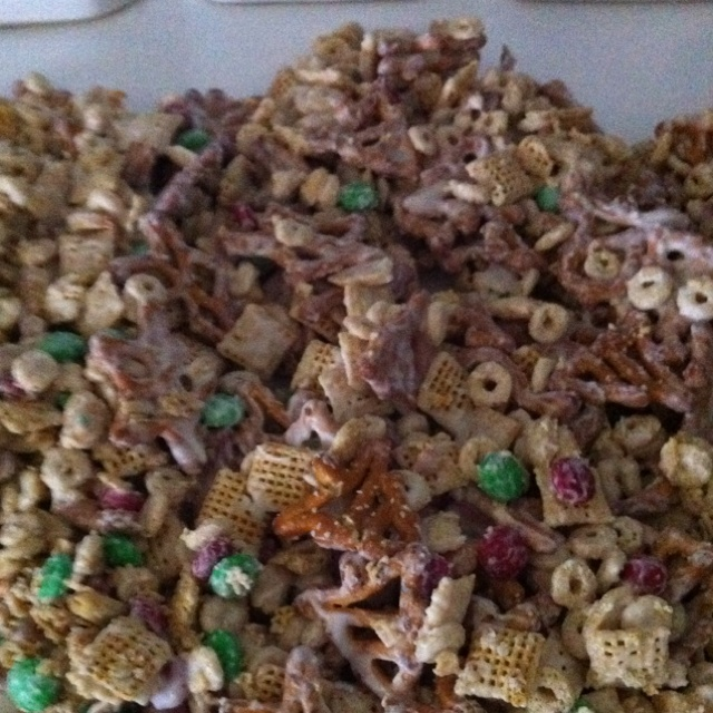 White Chocolate covered party mix Chex mix Cheerios Pretzels m&m's Peanuts Almond bark (melted) Mix all together pour on wax paper let harden. Then enjoy