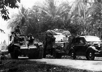 A column of Japanese tanks, trucks and cars advancing to the Southern part of the peninsula of Malacca after defeating the British Second Division at Kampar. Malaysia, January 1942 - pin by Paolo Marzioli