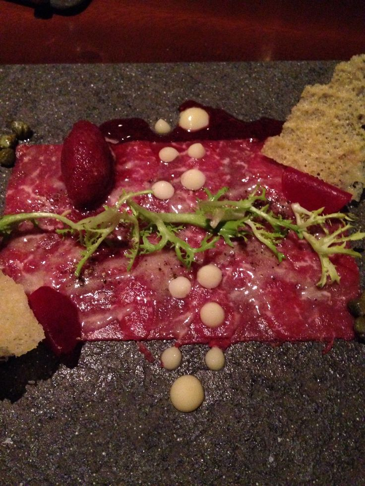 Angus beef carpaccio with aioli, capers and truffle dressing