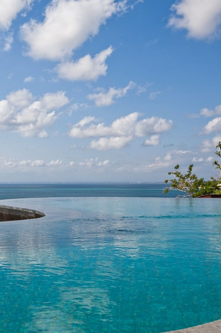 Feel suspended above Bali's best surf from the hotel's dual-level infinity pool.