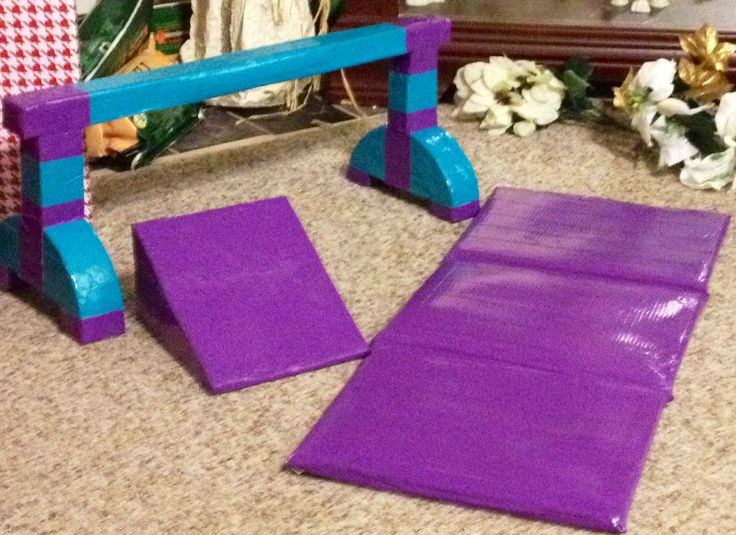 Additional gymnastic pieces:  cheese wedge & balance beam from duct tape & floral foam; mat from spongy foam sheets & duct tape (fits under parallel bars)