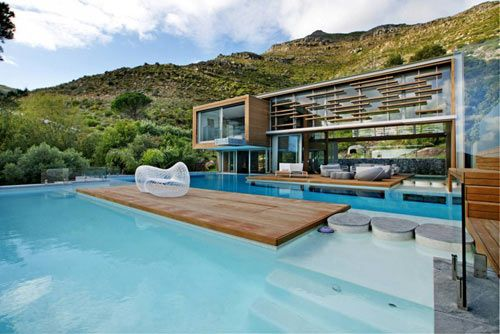 Spa House, designed by Metropolis Design, is the perfect name for this house, which is located on a mountainside overlooking Hout Bay in Cape Town, South Africa.