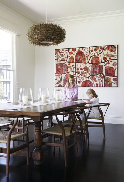 Simple Dining room - Dark wood, Rosetta Santucci art, cool nest fixture