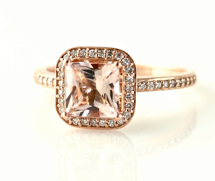 Morganite stone with rise gold band. A simply beautiful ring.