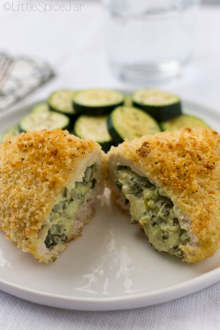 Spinach and cream cheese stuffed chicken breasts. Breaded with panko and baked! Perfect for weekday dinners and entertaining!