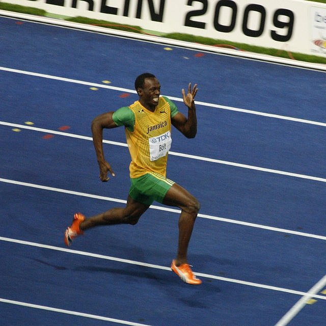 Usain Bolt a few strides away from his 19.19 world record in the 200m. Shot from my press seat, Berlin, 20-Aug-2009.    Photo by Bob Ramsak / piran café      World record holder Visit http://www.joggingtoloseweight.org