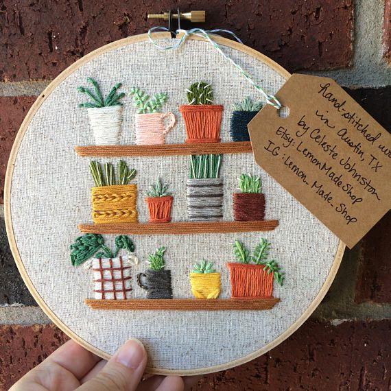 tiny houseplants on shelves embroidered hoop