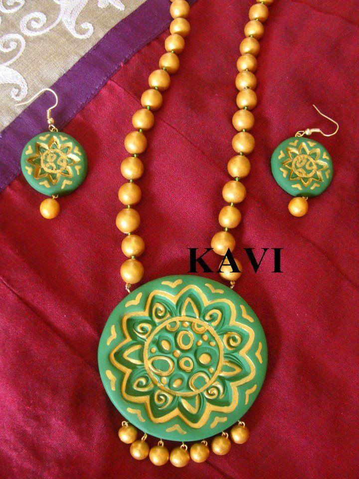 Handmade terracotta jewelry painted on green & gold https://www.facebook.com/KavisTerracottajewellery