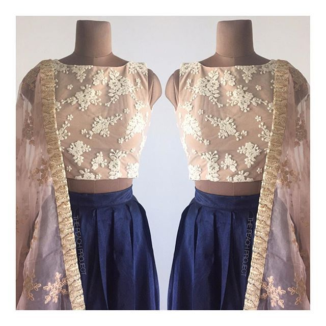Signature Nude Crop Top X Navy Box Pleat Skirt X The Frozen Rhubarb Dupatta To order: email ayesha@thepeachproject.in #sari #croptop #sheerblouse #organza #sariblouse #sexysari #sexyblouse #sari #thesaristory #dinkishaadi #desibridesmaids101 #desibridesmaids #americandesi #thepeachproject #indianbridesmaids #desibride #southasianwedding #engagementphotoshoot #registrybride #londondesi #organza #bridalparty #diwali #fallcollection #festiveseason #blackbeauty
