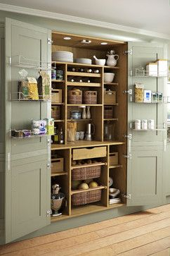 Built in pantry has lots of great ideas for organizing, like the slide out baskets.
