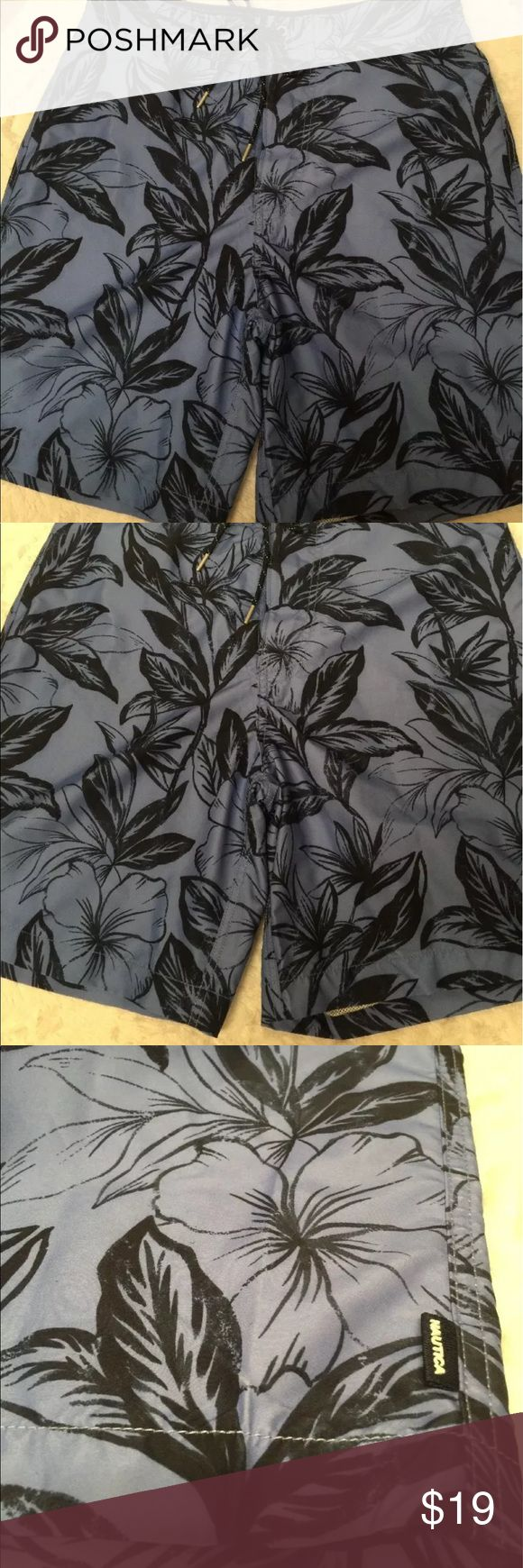 "NAUTICA Men's  Blue Black Swim Trunks Sz 30 This Nautica Black and Blue Floral Swim Trunks is Size 30. It features a built in mesh underwear and adjustable waist drawstrings. 30"" waist, 20"" length. Nautica Swim Swim Trunks"