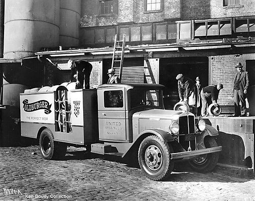 Vintage 1930s photograph of a classic Oldburger Beer (United Brewing Company) truck in Indiana. Laborers are seen in work clothing.
